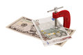 Dollars and euros clamped in vise. Stock Image