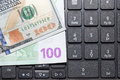 Dollars and euros on a laptop keyboard Royalty Free Stock Photo
