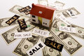 Dollars and Houses Stock Image