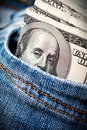 Dollars in jeans pocket Stock Photography