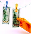 Dollars laundering two hundred dollar bills hanging from the rope and drying concept dirty money Stock Photo