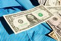 Dollars money lying in the blue shirt Royalty Free Stock Images