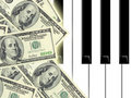Dollars and piano Stock Photography