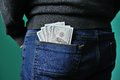Dollars in the pocket of jeans Royalty Free Stock Photo