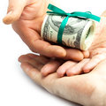 Dollars rolled into a tube in the hands tied with ribbon Royalty Free Stock Images