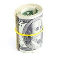 Dollars rolled into a tube tied with an elastic band on white Royalty Free Stock Image