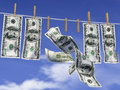 Dollars on a rope with clothespins hanging the background of sky Stock Photo