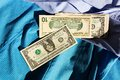 Dollars on a shirt american banknotes lying blue Stock Photos