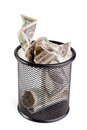 Dollars in a trash bin isolated on white Stock Photos