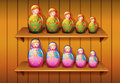 Dolls arranged in the wooden shelves illustration of Royalty Free Stock Images