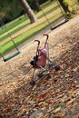 Dolls pram on empty playground Royalty Free Stock Photo