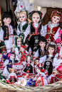 Dolls for sale in romanian traditional clothes souvenir bazaar Stock Photos