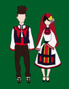 Dolls in traditional bulgarian costumes male and female green background Royalty Free Stock Photos