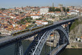 Dom luis i bridge with metro porto portugal on the monumental arched are riding trains and walking people across the douro river Stock Image