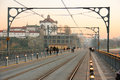 Dom luis i bridge and monastery porto portugal tram tracks on dome of the mosteiro da serra do pilar in the background at sunset Stock Photo