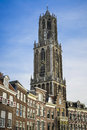 Dom tower utrecht holland the of the cathedral above a row of historical houses of Stock Photography