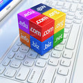 Domain concept. Cubes on white laptop keyboard. Royalty Free Stock Photo