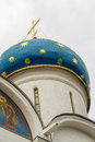 Dome church closeup blue with a gold cross Royalty Free Stock Images