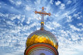 Dome and cross on the orthodox church under a spectacular spring sky in belarus shape resembles a burning candle drop of Stock Photography