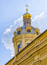 The dome of the Peter and Paul cathedral on the background of clouds. Royalty Free Stock Photo