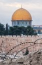 Dome rock masjid qubbat as sakhrah barbed wire foreground jerusalem israel Stock Photo