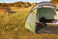 Dome tent pitched field wild camping great outdoors front flap open showing interior copy space left text Royalty Free Stock Images