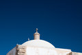 Domed roof of a little portugese chapel with seagulls sitting on it against blue sky Stock Photography