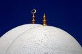 Domes on a mosque main sheikh zayed grand abu dhabi show brillaint white against the blue sky Stock Photos