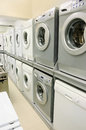 Domestic appliance store rows of washing machines selling in Stock Photos