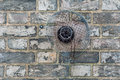 Domestic exhaust vent on a brick wall Royalty Free Stock Photo