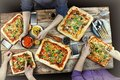 Cutting pizza. Domestic food and homemade pizza. Enjoying dinner with friends. Top view of group of people having dinner together Royalty Free Stock Photo
