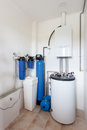 A domestic household boiler room with a new modern gas boiler , heating electric warm water system and pipes. Royalty Free Stock Photo