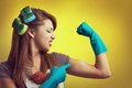 Domestic power strong woman housewife showing muscular strength Stock Photo