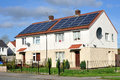 Domestic roof mounted solar panels on residential houses Royalty Free Stock Photo