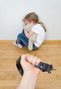 Domestic violence concept little girl crying in the corner Stock Photo