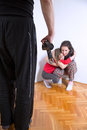 Domestic violence husband threatened with a belt Stock Image
