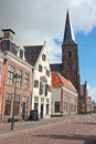 Dominating catholic church tower spire in the fishing village town of harlingen Royalty Free Stock Images