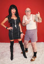 Dominatrix Woman and Scared Newcomer Stock Image