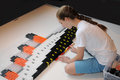 Domino day teenager girl builts the titanic with blocs Stock Image