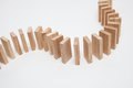 Domino effect - row of white dominoes Royalty Free Stock Photo