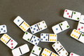 Domino effect shot. Look down for domino game on black background. Dominoes falling in a row in front. Dominoes Game Royalty Free Stock Photo