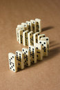 Dominoes on brown background Stock Images