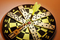 Dominoes on Dart Board Royalty Free Stock Photos