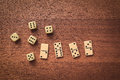 Dominoes and dice on a wooden table Royalty Free Stock Images