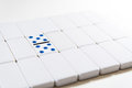 Dominoes double five bright high key photo on white of game dominoe in the middle of blank Royalty Free Stock Photo