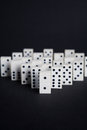 Dominoes leader buissnes concept on black background Royalty Free Stock Photo