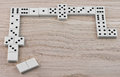 Dominoes playing top view of on wooden table Royalty Free Stock Images