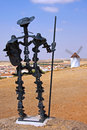 Don quijote statue between medival museum windmills on the route in mota del cuervo spain Royalty Free Stock Image