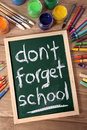 Don't forget school, back to school concept, desk, blackboard, vertical Royalty Free Stock Photo