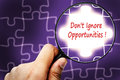 Don t ignore opportunities word magnifier and puzzles Royalty Free Stock Images